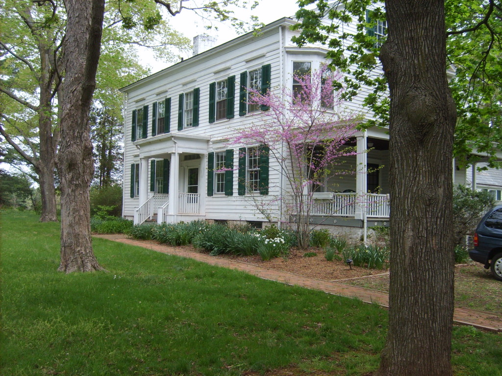 A late Greek Revival style house built in 1860 on land once part of the 500-acre farm of the Van derVeer family